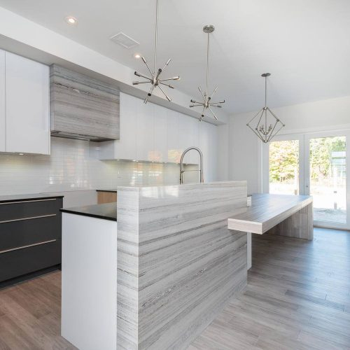 London Home Builders Millstone Homes - Mondrian White and Grey Cabinets Metal Light Fixture