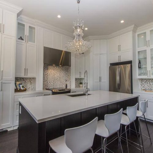 London Home Builders Millstone Homes - Nova Tall Cabinets White Metal Light Fixture Tile Backsplash 1