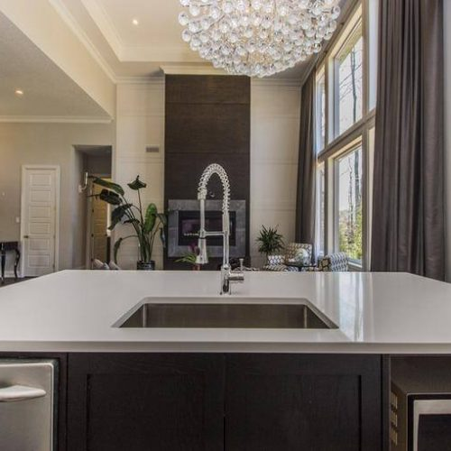 London Home Builders Millstone Homes - Nova White Stone Island Built in Sink 1