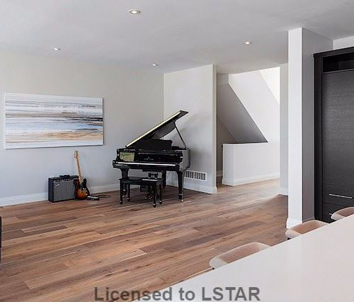 London Home Builders Millstone Homes - Piano Room Light Floors
