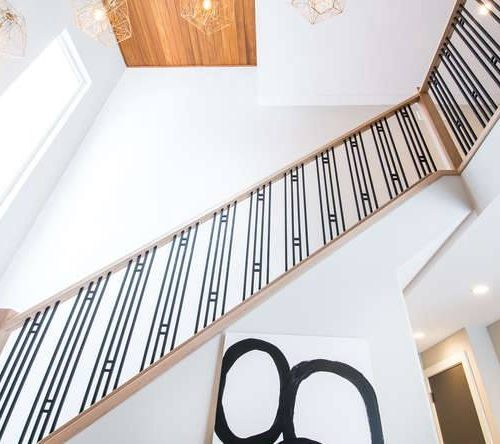 London Home Builders Millstone Homes - White Walls Cast Iron Staircase Wood Banister